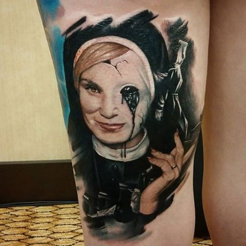 Colored horror style arm tattoo of demonic mother