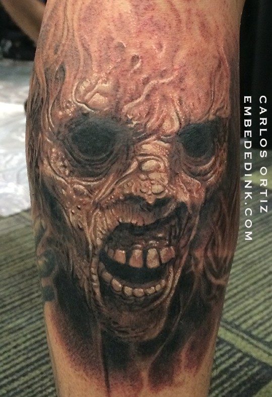 Colored horror style big leg tattoo of creepy monster face
