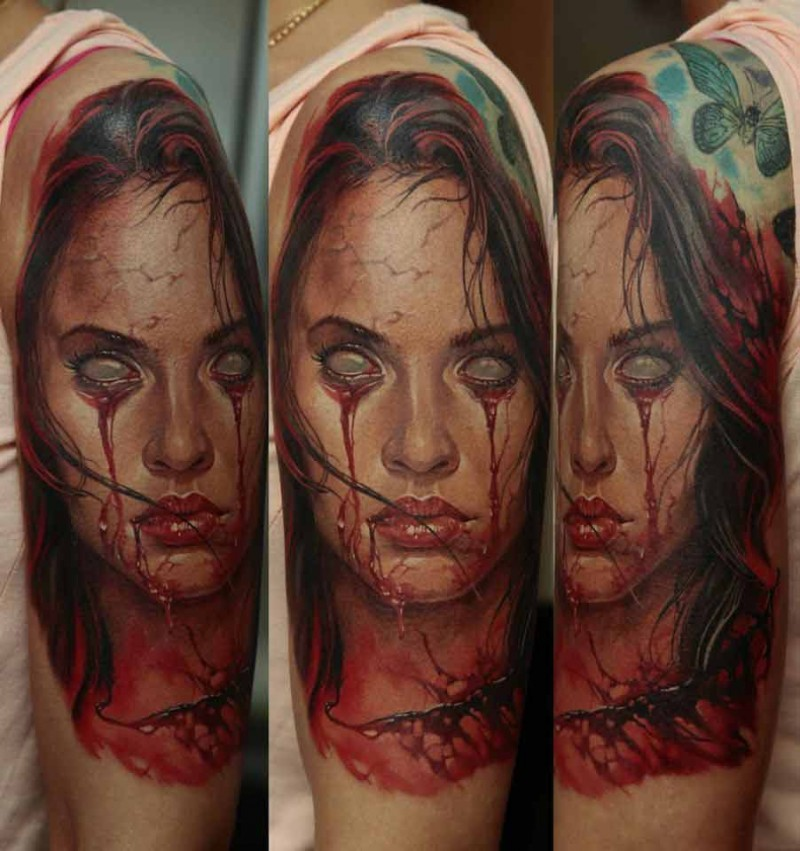 Colored horror style bloody woman portrait tattoo on shoulder