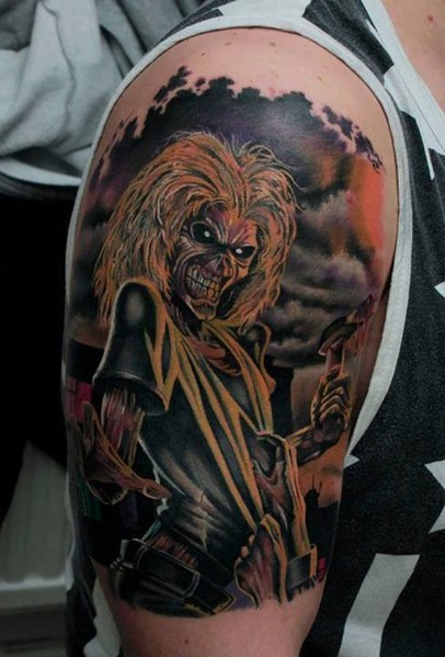 Colored horror style colored shoulder tattoo of creepy monster