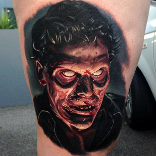 Colored horror style colored thigh tattoo of zombie face