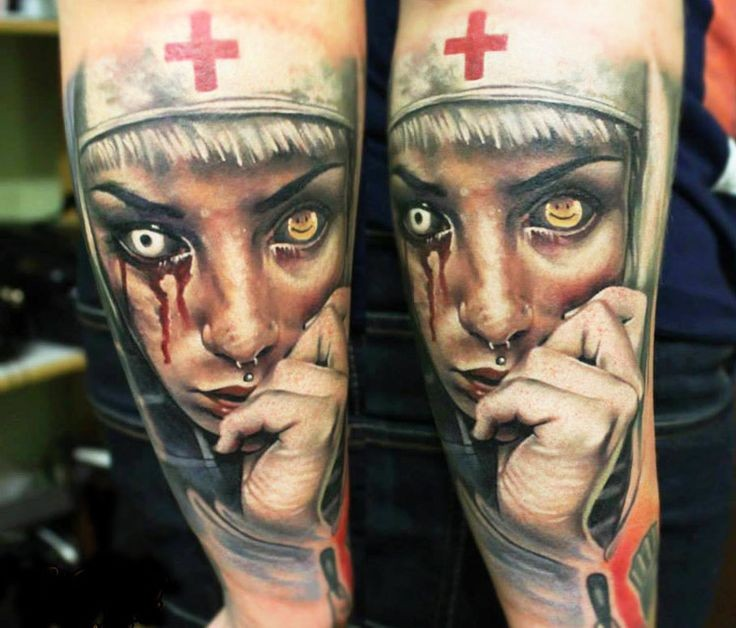 Colored horror style creepy looking arm tattoo of bloody monster nurse