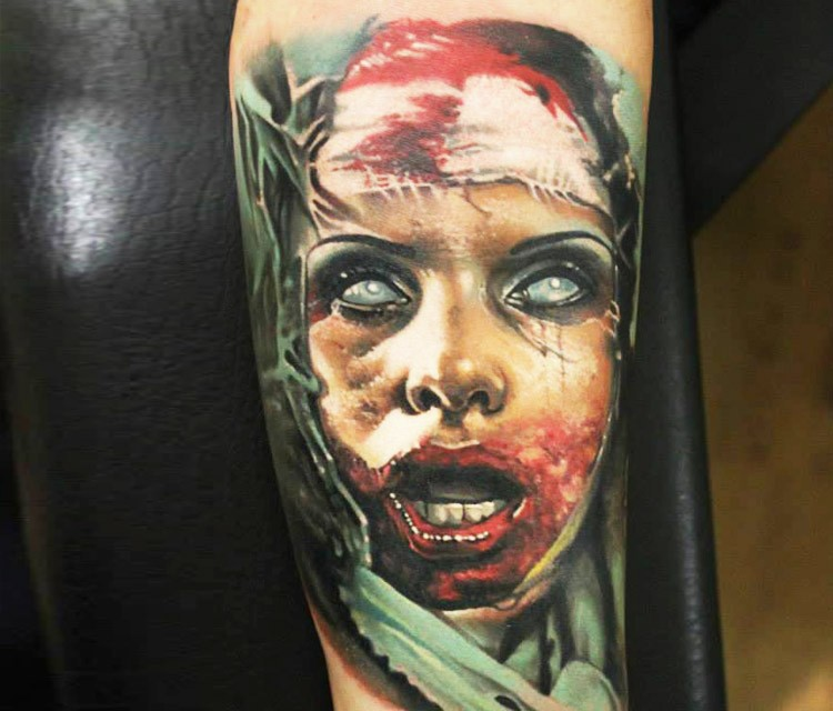 Colored horror style creepy looking biceps tattoo of bloody woman