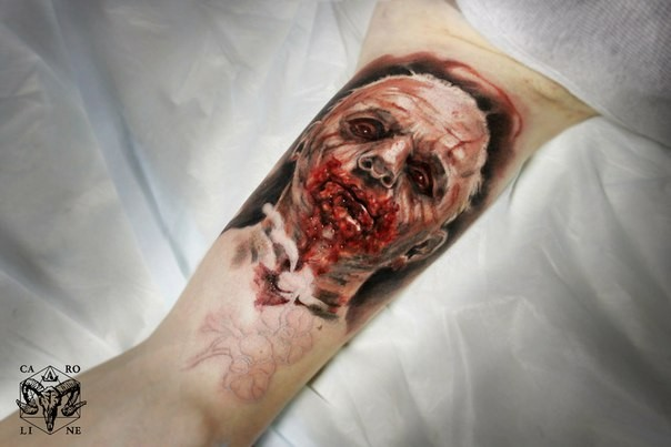 Colored horror style creepy looking biceps tattoo of bloody man face