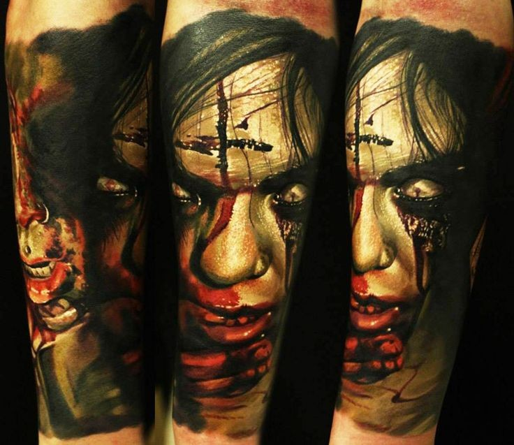 Colored horror style creepy looking bloody monster woman tattoo