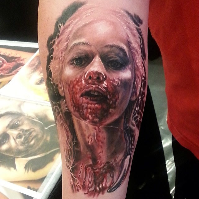 Colored horror style creepy looking bloody arm tattoo of woman face