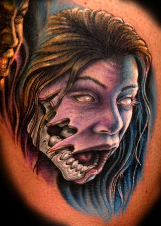 Colored horror style creepy looking demonic woman face tattoo