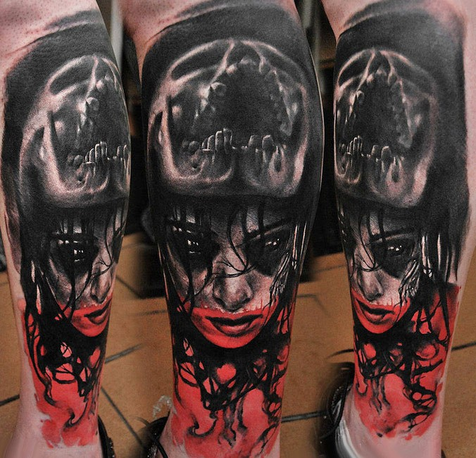 Colored horror style creepy looking leg tattoo of demonic woman with skull
