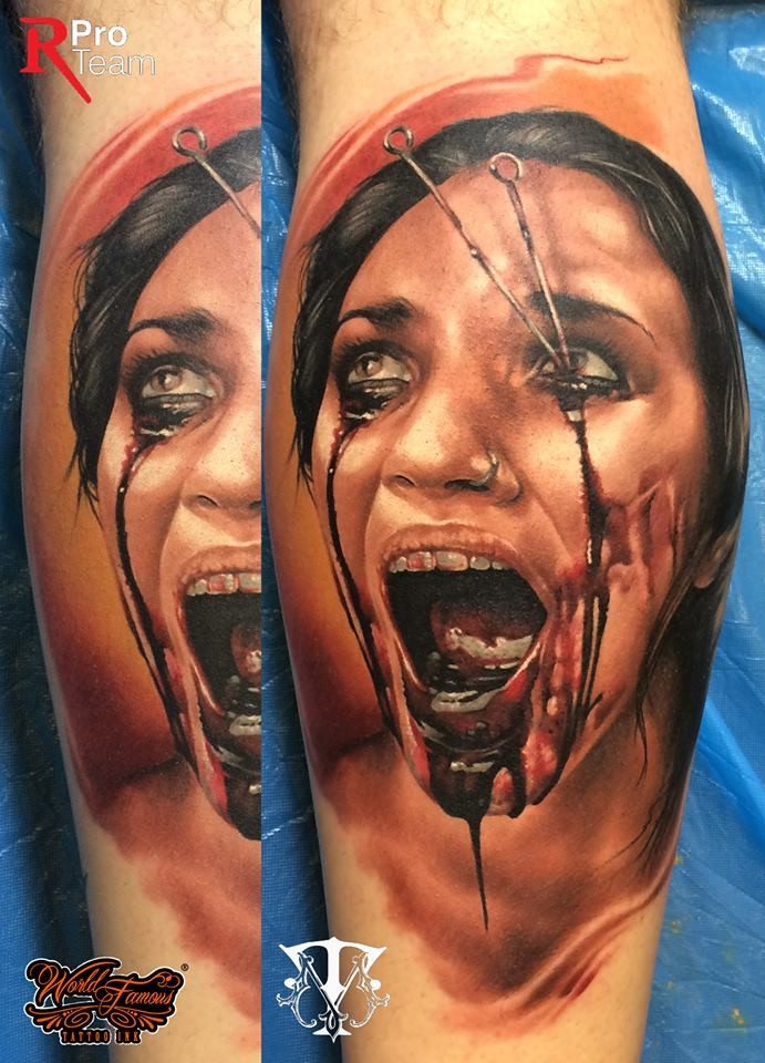 Colored horror style creepy looking leg tattoo of bloody woman