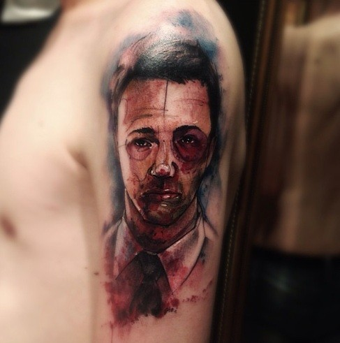 Colored horror style creepy looking man tattoo on shoulder