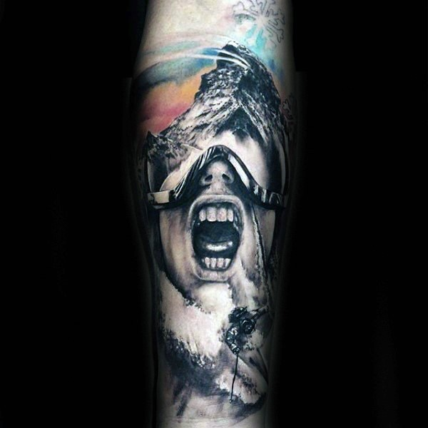 Colored horror style creepy looking man in mask tattoo on forearm