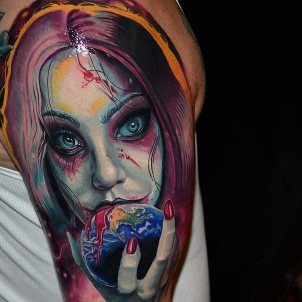 Colored horror style creepy looking shoulder tattoo of vampire woman