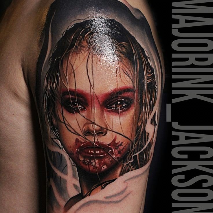 Colored horror style creepy looking shoulder tattoo of bloody woman face