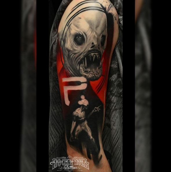 Colored horror style creepy looking shoulder tattoo of evil monster