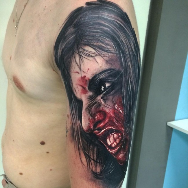 Colored horror style creepy looking shoulder tattoo of bloody woman