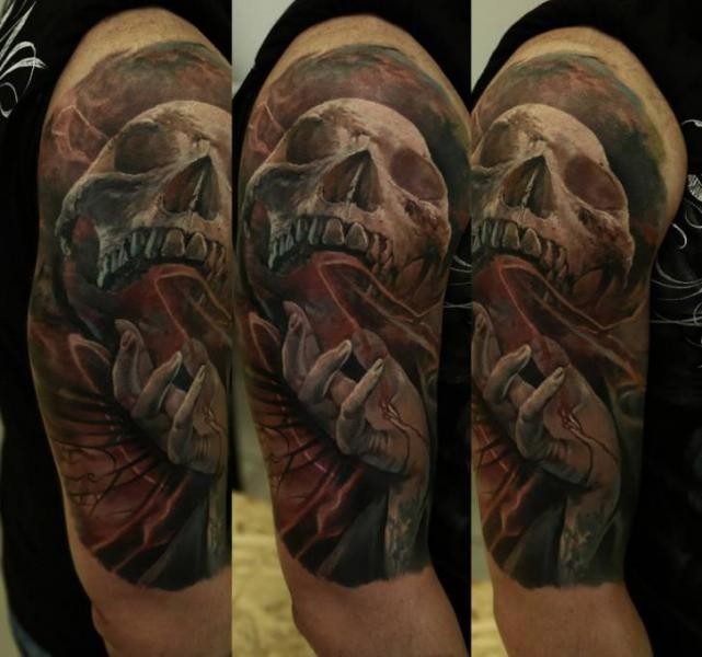 Colored horror style creepy looking shoulder tattoo of human skull with coffin and bloody hand