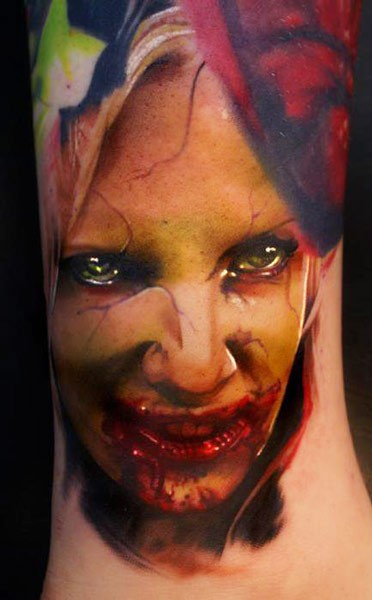 Colored horror style creepy looking woman face tattoo