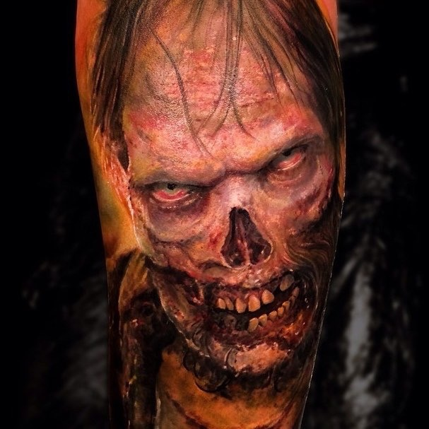 Colored horror style creepy looking zombie tattoo on arm