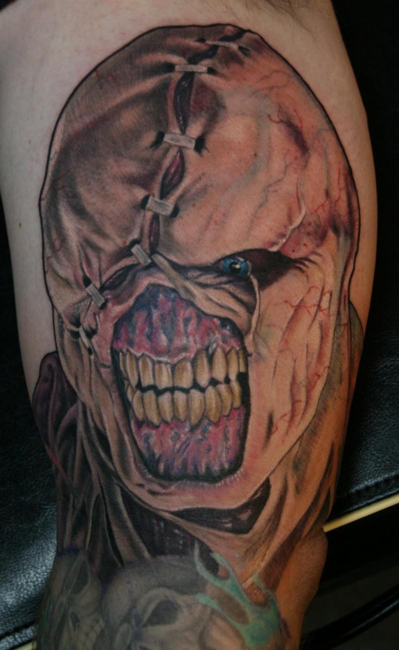 Colored horror style demonic biceps tattoo of Resident Evil monster
