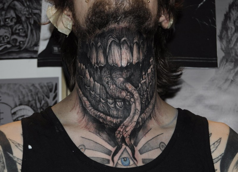 Colored horror style evil monster moth with tongue tattoo