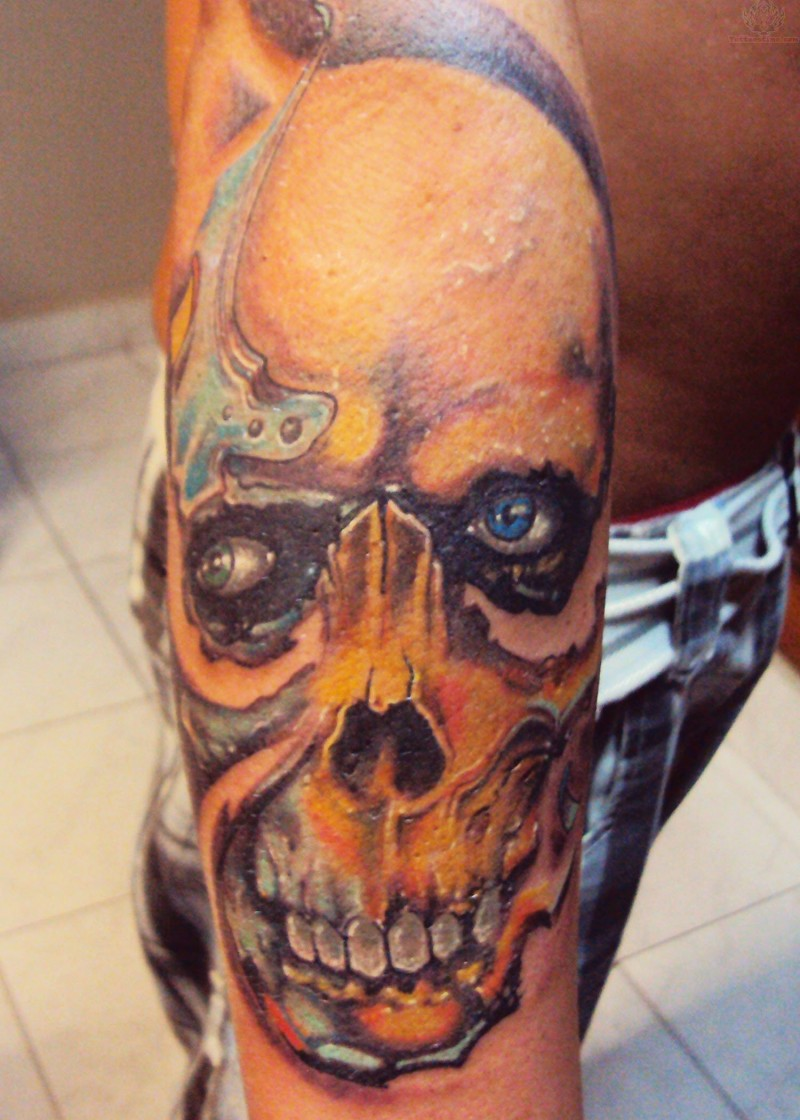 Colored horror style forearm tattoo of human skull