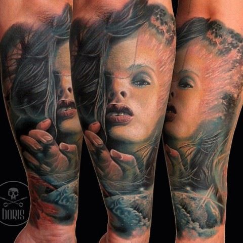 Colored horror style forearm tattoo of mystical witch