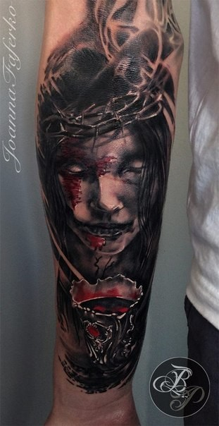 Colored horror style forearm tattoo of woman with blood and vine