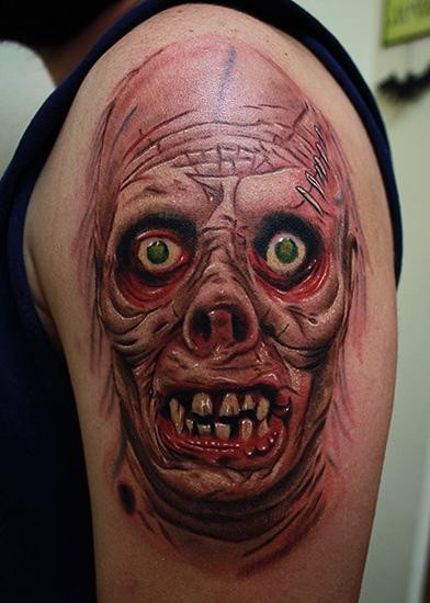 Colored horror style large shoulder tattoo of monster face