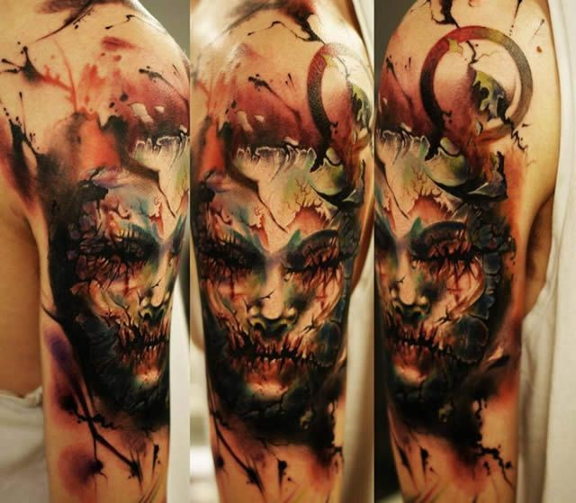 Colored horror style large shoulder tattoo of mystical face