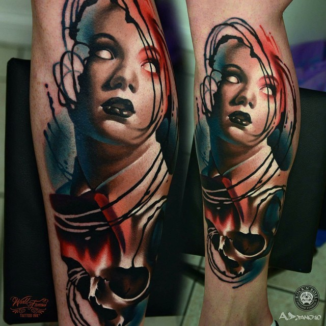 Colored horror style leg tattoo of demonic woman with skull