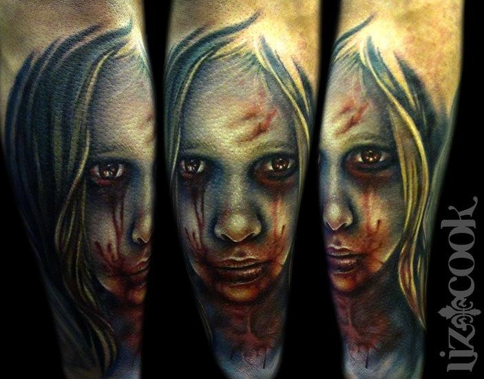 Colored horror style mystical looking arm tattoo of bloody girl