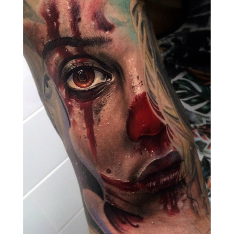 colored horror style realistic looking bloody woman face tattoo on hand. Black Bedroom Furniture Sets. Home Design Ideas