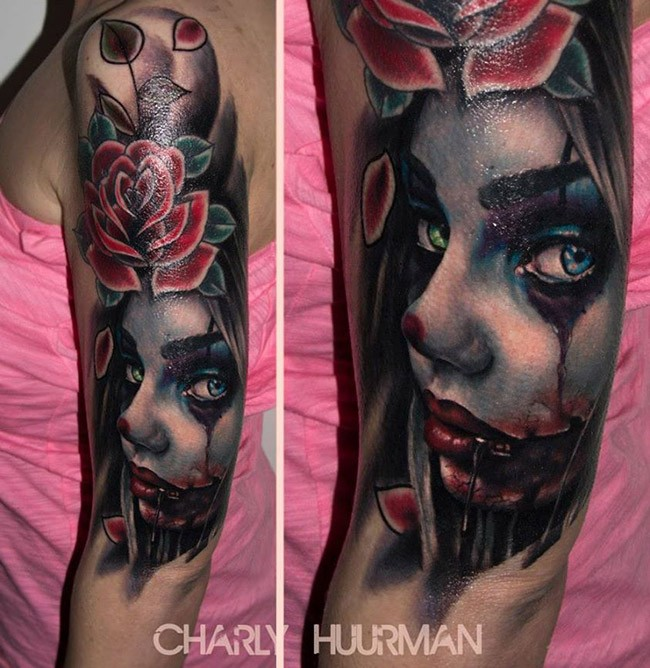 Colored horror style shoulder tattoo of woman portrait with flower