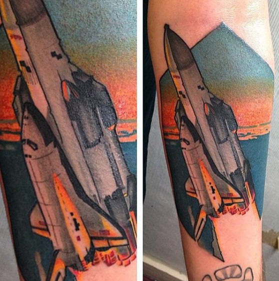 Colored illustrative style arm tattoo of space ship