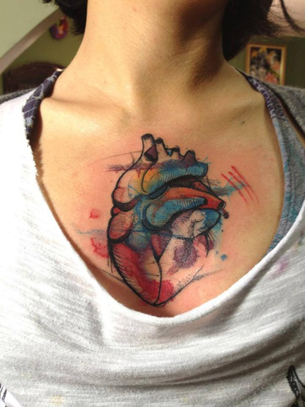 Colored illustrative style chest tattoo of human heart