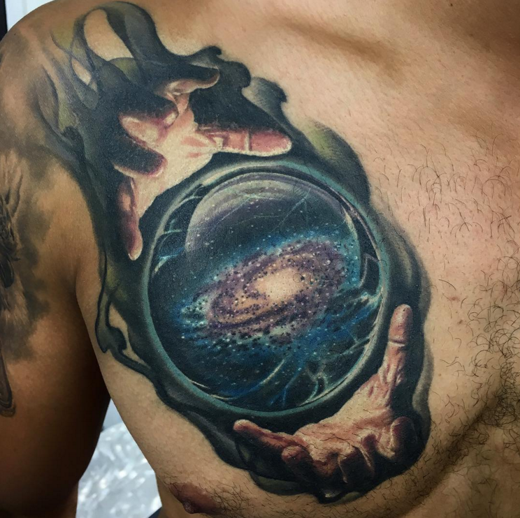 Colored illustrative style chest tattoo of magical orb with space