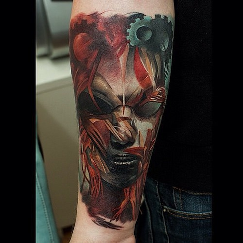 Colored illustrative style forearm tattoo of creepy woman face