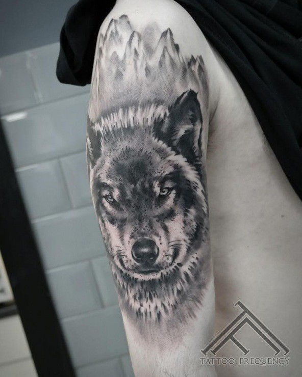 Colored illustrative style shoulder tattoo of evil wolf head