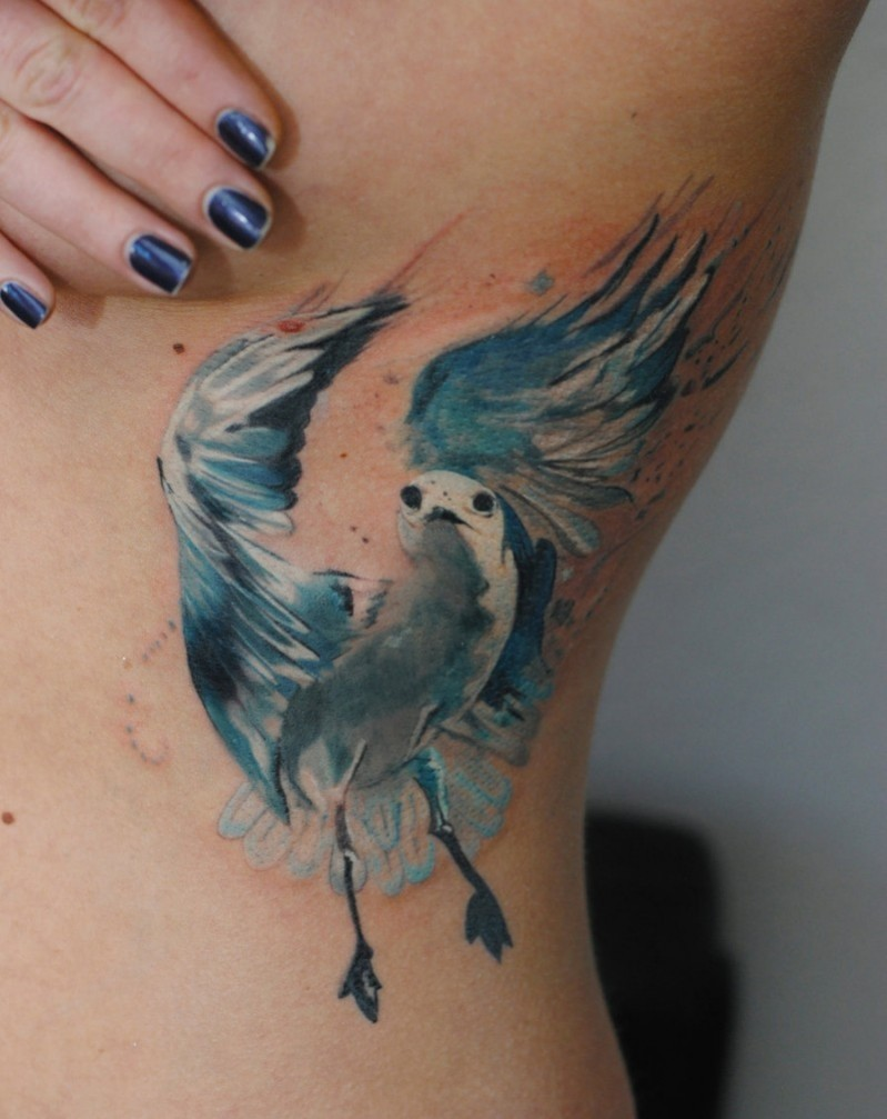 Colored illustrative style side tattoo of beautiful pigeon