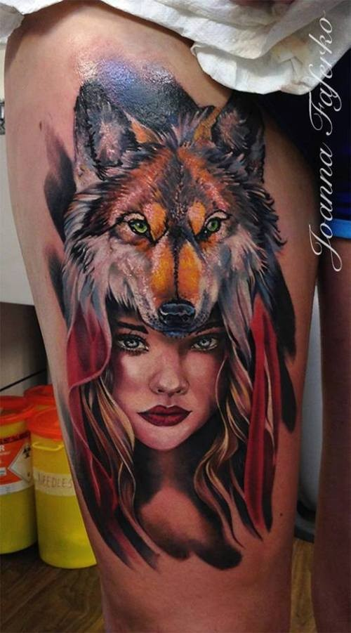 Colored illustrative style thigh tattoo of woman with wolf helmet