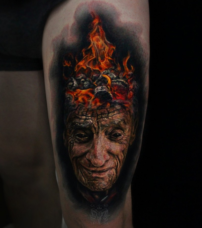 Colored incredible looking thigh tattoo of mn with burning head