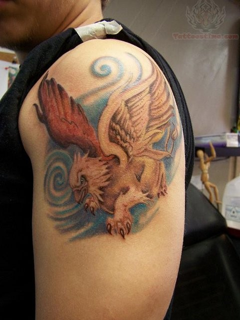 Colored ink griffin tattoo on shoulder