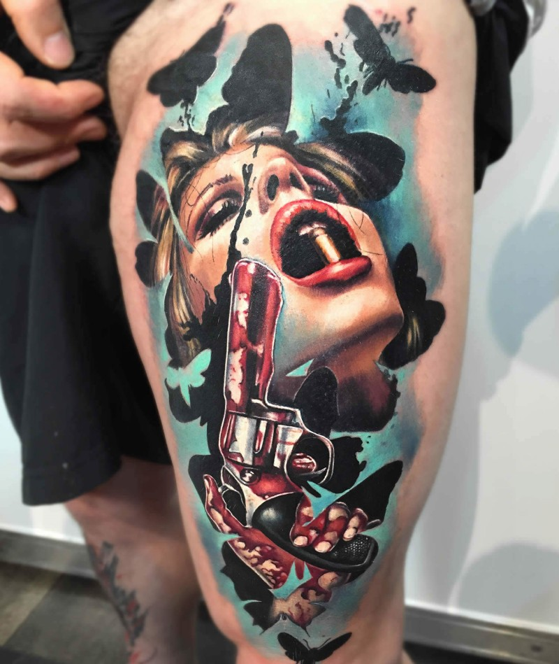 Colored large thigh tattoo of woman with bloody pistol and butterflies