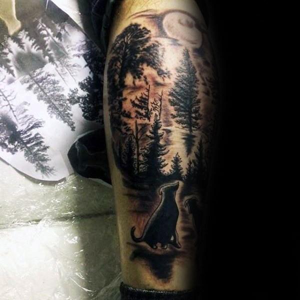 Colored leg tattoo of cat in dark forest