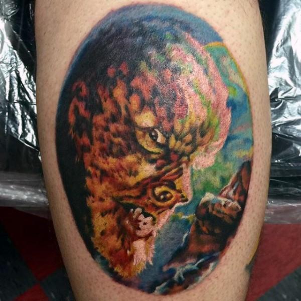 Colored leg tattoo of half werewolf half human