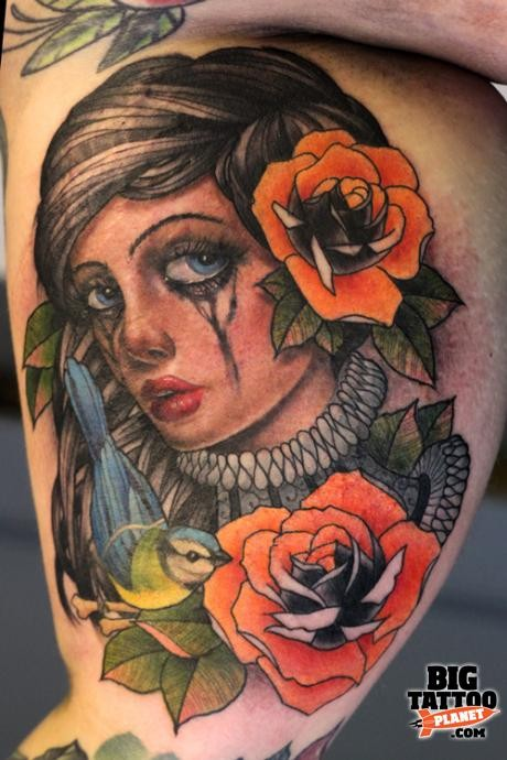 Colored new school colored crying woman portrait tattoo on biceps with flowers and bird