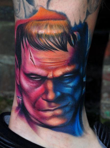 Colored portrait style leg tattoo of Frankenstein monster