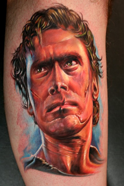 Colored portrait style leg tattoo of famous actor face