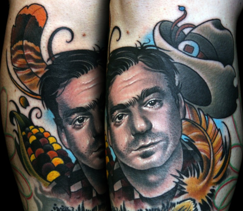 Colored portrait style tattoo of cowboy with hat and feather