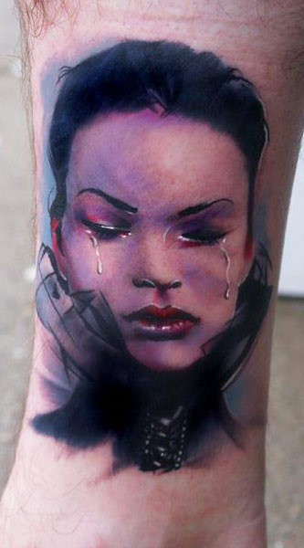 Colored realistic looking crying woman tattoo